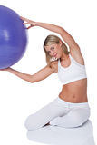 Fitness series - Young woman with purple ball Stock Photo