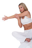 Fitness series - Young woman stretching Royalty Free Stock Photography