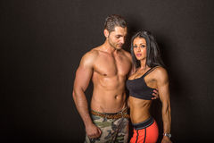 Fit couple. A fit and sporty couple on a black background Stock Image