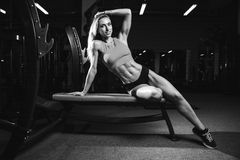 Fitness sexy mode on diet with long female legs gym Royalty Free Stock Images