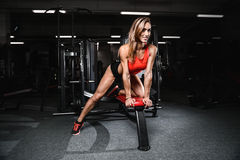 Fitness sexy mode on diet with long female legs gym Stock Image