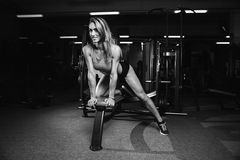 Fitness sexy mode on diet with long female legs gym Stock Photos