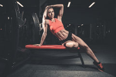 Fitness sexy mode on diet with long female legs gym Royalty Free Stock Photography