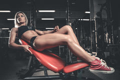 Fitness mode on diet with long female legs gym. Fitness mode on diet with long female legs in the gym stock image