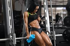Fitness woman showing abs and flat belly. Beautiful muscular girl, shaped abdominal royalty free stock photo