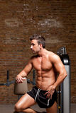 Fitness shaped muscle man posing on gym Royalty Free Stock Image
