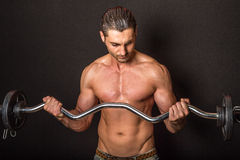 Fitness shirtless male with barbell Royalty Free Stock Photography