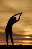 Fitness silhouette reach arms up Stock Photo