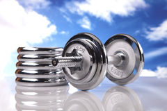 Fitness on the sky! barbells Stock Photos