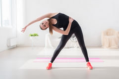 Fitness slim girl doing yoga stretching exercise Stock Photo