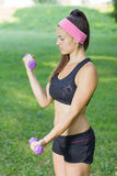 Fitness Slim Woman Training With Dumbbells Royalty Free Stock Photography
