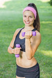 Fitness Slim Woman Training With Dumbbells Royalty Free Stock Images