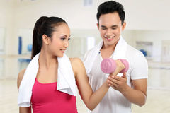 Fitness Smiling young man and woman Royalty Free Stock Photos