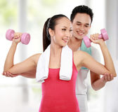 Fitness Smiling young man and woman Royalty Free Stock Photo