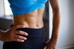 Fit woman with perfect six-pack abs close up royalty free stock photography