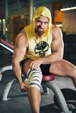 Fitness and Sport. Athletic man bodybuilder preparing for training. Royalty Free Stock Image