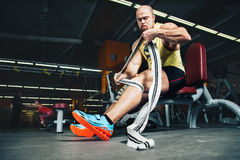 Fitness and Sport. Athletic man bodybuilder preparing for training. Stock Photo