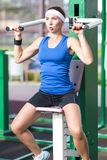 Positive caucasian female athlete in good fit having training outdoors.equipped in professional clothing. Fitness and sport concepts. Positive caucasian female Royalty Free Stock Image