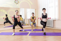 Fitness and Sport Concepts. Three Caucasian Fit Women Performing Stock Photo