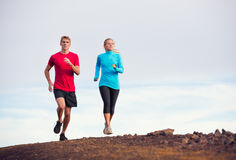 Fitness sport couple running jogging outside Stock Image