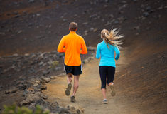 Fitness sport couple running jogging outside on trail. Fitness sport couple jogging outside, training together outdoors. Running on amazing nature trail Royalty Free Stock Image