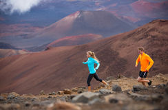 Fitness sport couple running jogging outside on trail Royalty Free Stock Photography