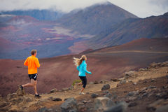 Fitness sport couple running jogging outside on trail. Fitness sport couple jogging outside, training together outdoors. Running on amazing trail at sunset Stock Photography