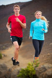 Fitness sport couple running jogging outside on trail. Fitness sport couple jogging outside, training together outdoors. Running on nature trail Royalty Free Stock Photography