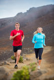 Fitness sport couple running jogging outside on trail. Fitness sport couple jogging outside, training together outdoors. Running on nature trail Royalty Free Stock Images