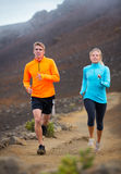 Fitness sport couple running jogging outside on trail. Fitness sport couple jogging outside, training together outdoors. Running on nature trail Royalty Free Stock Image