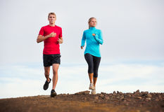 Fitness sport couple running jogging outside on trail. Fitness sport couple jogging outside, training together outdoors. Running on nature trail Stock Photography