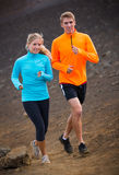 Fitness sport couple running jogging outside on trail. Fitness sport couple jogging outside, training together outdoors. Running on nature trail Stock Photo