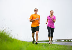 Fitness sport couple running jogging outside Stock Photos