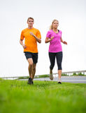 Fitness sport couple running jogging outside Royalty Free Stock Images