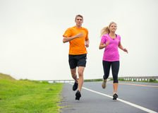 Fitness sport couple running jogging outside Stock Photography