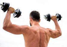 Fitness and sport equipment. athletic body. Dumbbell gym. man sportsman weightlifting. steroids. Muscular back man. Exercising in morning with barbell. Healthy stock photo