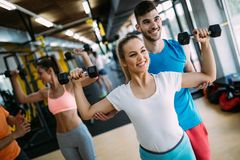 Fitness, sport, exercising and healthy lifestyle concept. Group of happy people in gym stock photos