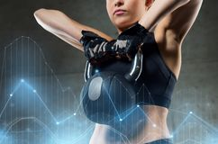 Woman with kettlebell in gym Royalty Free Stock Photo