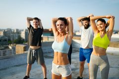 Fitness, sport, friendship and healthy lifestyle concept . Group of happy people exercising. Fitness, sport, friendship and healthy lifestyle concept - group of stock image