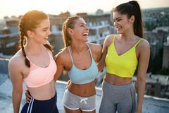 Fitness, sport, friendship and healthy lifestyle concept . Group of happy people exercising. Fitness, sport, friendship and healthy lifestyle concept - group of royalty free stock photo