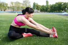 Fitness sport girl in fashion sportswear doing yoga fitness exercise in the street, outdoor sports royalty free stock image