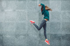 Fitness sport girl in the street. Fitness sport girl in fashion sportswear dancing hip hop in the street, outdoor sports, urban style Stock Image