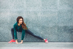 Fitness sport girl in the street. Fitness sport girl in fashion sportswear doing yoga fitness exercise in the street, outdoor sports, urban style Royalty Free Stock Images