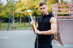 Fitness sport man workout outdoor. with hammer and tractor tire. stock images