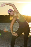 Fitness sport model doing exercises during outdoor work out on s Stock Photography