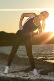 Fitness sport model doing exercises during outdoor work out on s Stock Images