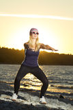 Fitness sport model doing exercises during outdoor work out on s Stock Photo