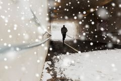 Man running along subway tunnel in winter Royalty Free Stock Photo