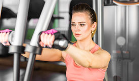 Fitness, sport, powerlifting and people concept - sporty woman doing workout in gym. Fitness, sport, powerlifting and people concept - sporty woman doing Royalty Free Stock Photo