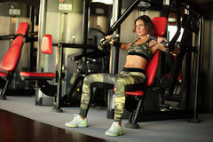 Fitness, sport, powerlifting people concept sporty woman exercising barbell. Fitness, sport, powerlifting and people concept - sporty woman exercising with Stock Image